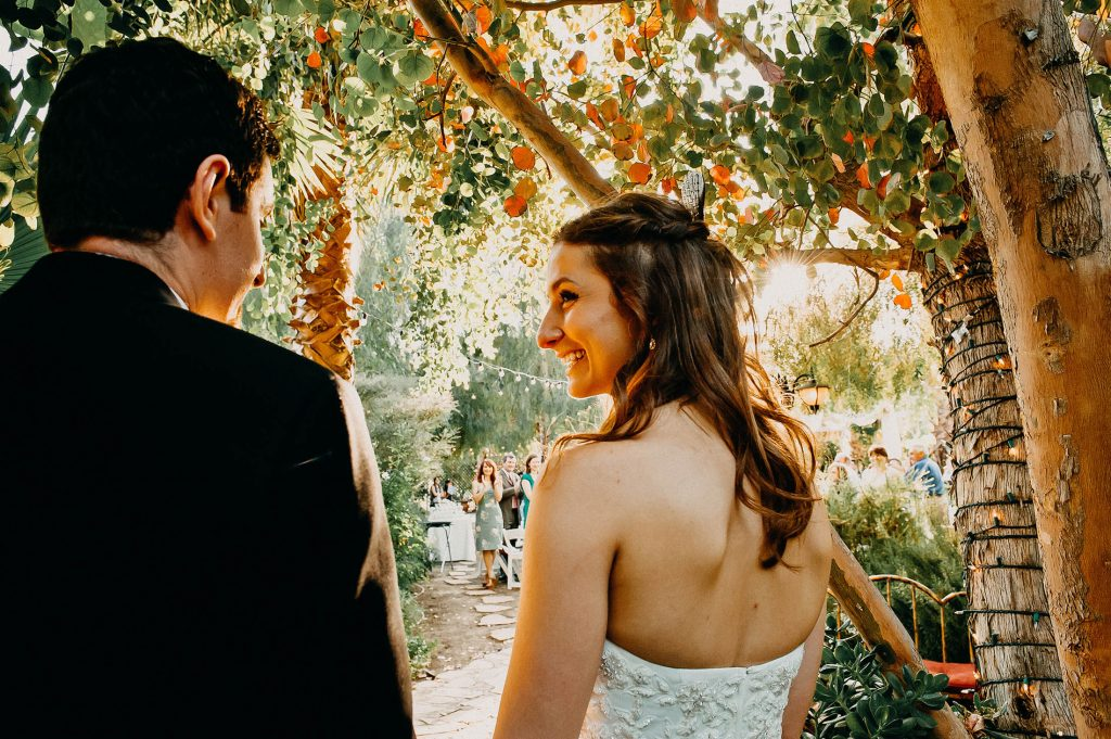 A bride smiles before their first entrance during a wedding reception in Calabasas, California. Wedding portfolio.